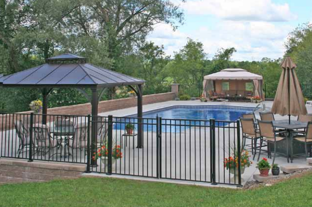 Outdoor patio with an inground pool and three outdoor covered seating areas